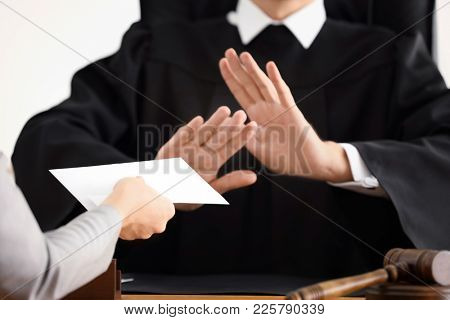Male judge refusing to take bribe from woman, closeup