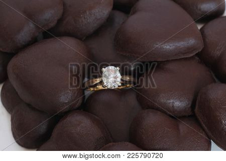 Oval Diamond Engagement Ring With 4 Prong Basket Setting & Yellow Gold Band Set Among Chocolate Hear