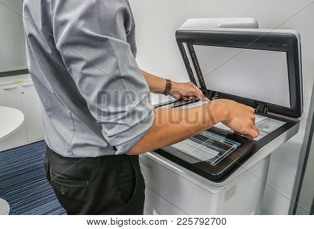 Close Up Businessman Use Printer To Scan Important And Confidential Documents In Office