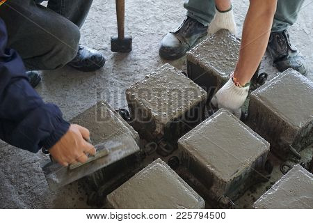 Cube Concrete Casting By Steel Mould And Worker Finishing Top Surface By Trowel