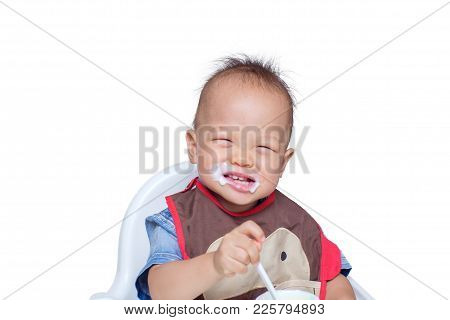 Portrait Of A Cute Little Asian 18 Months / 1 Year Old Toddler Baby Boy Child Eating Yogurt. Dirty F