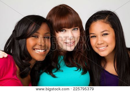 Diverse Group Of Teens Girls Smiling Isolated On White.