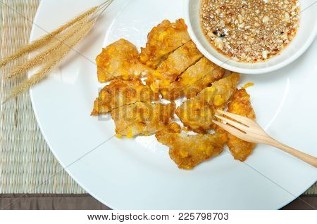 Sweet Corn Fritters,crispy Fried Corn In A White Plate On Bamboo Mat -table,snacks Thai Style.