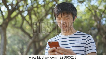 Man using mobile phone for sending sms