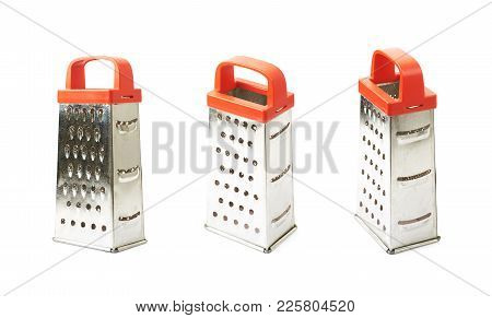 Metal Food Grater Utensil Isolated Over The White Background , Set Of Several Different Foreshorteni