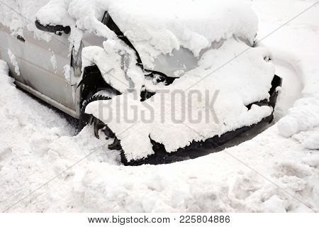 Abandoned Smashed Car In The Snow, Outdoor Shot