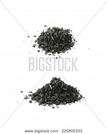 Pile Of Black Salt Crystals Isolated Over The White Background , Set Of Several Different Foreshorte