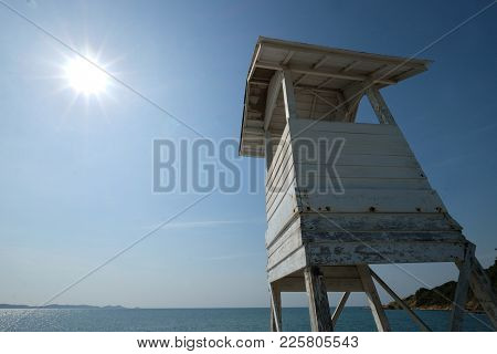 Wide Angle Of Wooden Lifeguard House On Sunny Blue Sky Day