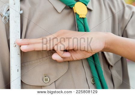 Hand Of A Boy Scout Presented Respect Action With His Weapon.concept Is Learning Scout Subject At Sc