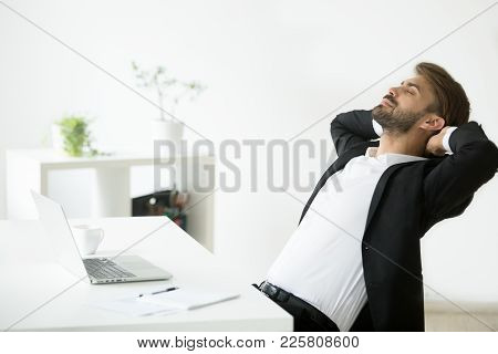 Successful Young Businessman In Suit Relaxing At Workplace With Laptop Finished Work, Relaxed Calm E