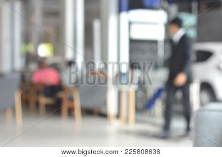 Man Wear Black Suit Who Is A Car Salesman And Customer Who Are Waiting For A Car Inspection At The C