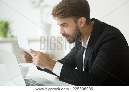 Amazed Businessman In Suit Feeling Shocked By Reading Mail, Surprised Entrepreneur Stunned By Unexpe