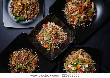 Asian Restaurant Family Dinner. Menu Meal Assortment. Meat And Veggie Salads For Balanced Nutrition