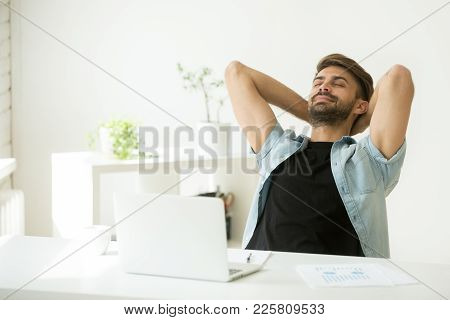 Relaxed Young Man Resting From Work On Laptop Holding Hands Behind Head, Successful Entrepreneur Rel