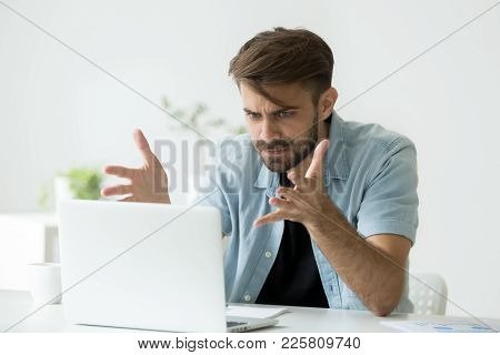 Frustrated Angry Entrepreneur Outraged By Laptop Problem, Furious Mad Man Using Computer Looking At