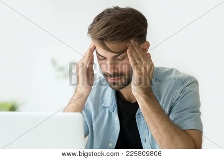 Young Man Touching Temples Trying To Focus Or Concentrate, Tired Exhausted Office Worker Feeling Hea
