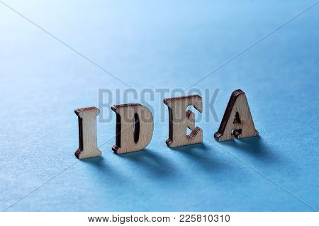 Idea From Wooden Letters On A Blue Background
