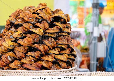 Pile Of Grilled Bagridae Fish, A Kind Of Catfish Family, In The Rattan Tray Prepared For Selling At