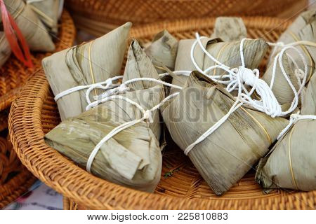 Rice Dumpling In Banana Leaf Tied By White Rope In Rattan Tray