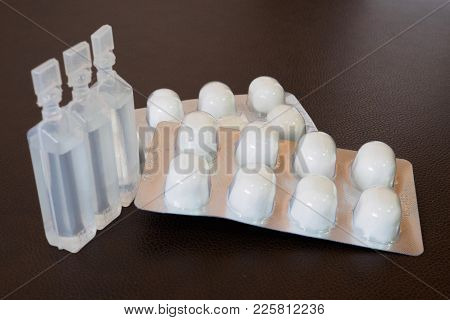 Sterile Cotton Ball And Sterile Water In Package.
