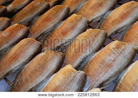 Raw Dried Salted Snakeskin Gourami Fish Or Sepat Siam On Grille