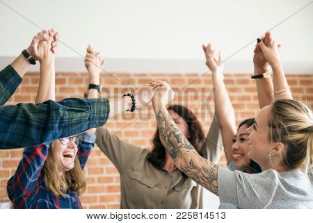 Business team raising their hands up to celebrate