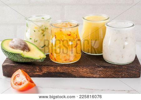 Set Of Classic Salad Dressings - Honey Mustard, Ranch, Vinaigrette, Lemon & Olive Oil,  On White Mar