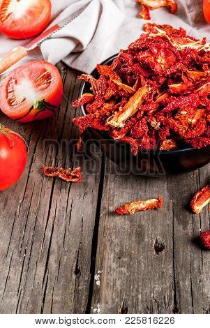 Homemade Sun-dried Organic Tomatoes, Crispy Tomato Chips, On An Old Rustic Wooden Table With Fresh T
