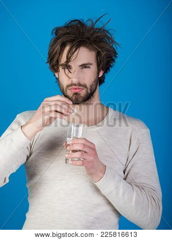 Man Drink Pill With Water, Illness, Insomnia. Man With Water Glass On Blue Background, Hangover. Hea