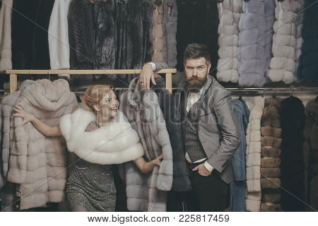Woman In Fur Coat With Man, Shopping, Seller And Customer. Fashion And Beauty, Winter, Fur. Couple I