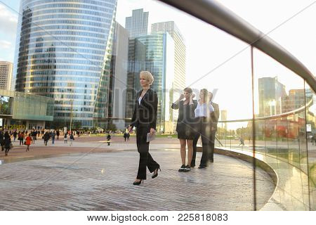 Gladden Businesswoman Going With Blue Document Case And Employees Background,  . Concept Of Blonde F
