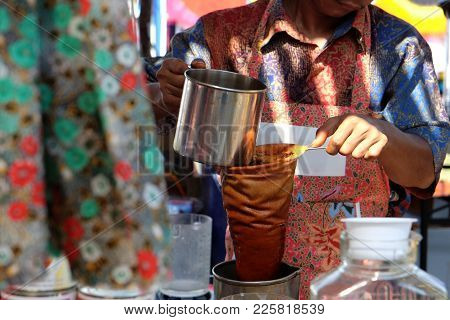Making Of Malay Traditional Tea, As Known As Teh Tarik, For Selling In Outdoor Street Market