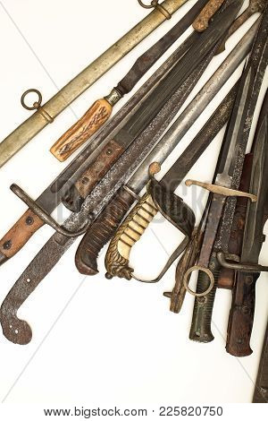Collection Of Vintage Weapons With The Hilts Of Old Swords And Daggers Forming A Side Border Over Wh