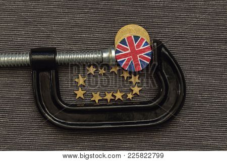 British Coin Is Clamp Pressure, Concept British  In A Vice Brussels