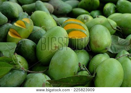 Pile Of Green Ripe Mangoes Being Sold In Local Market