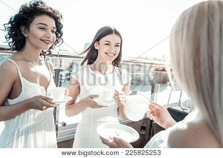 Rooftop Restaurant. Joyful Positive Attractive Woman Being On The Rooftop Of The Restaurant And Talk