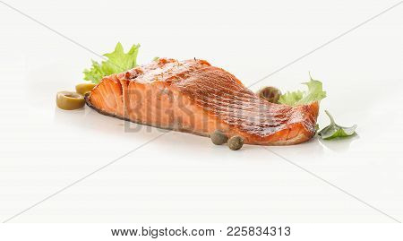 Baked Fillet Of Salmon With Olives, Capers And Lettuce On The White