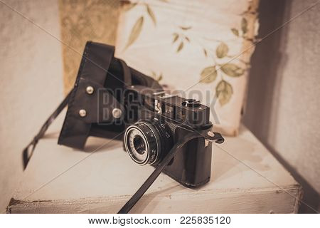 Vintage Film Camera With Leather Case On White Background