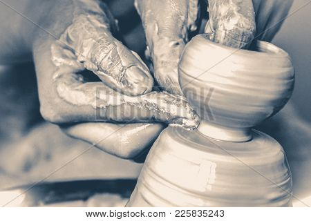 Photo In Old Vintage Style. A Man With His Hands Dub Wall Jug, Which He Sculpts Out Of Clay On A Cir