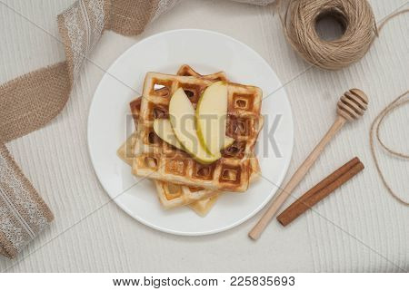 Rustic Waffles With Honey Spoon. Belgium Waffles With Apples And Cinnamon
