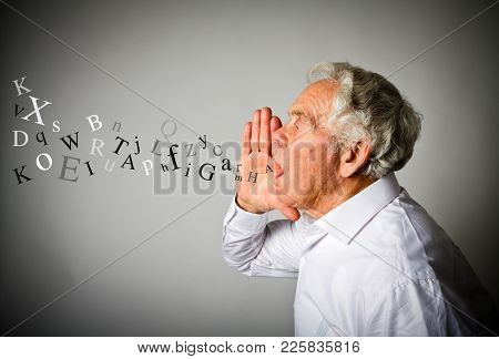 Old Man In White Is Screaming At Something. Letters.