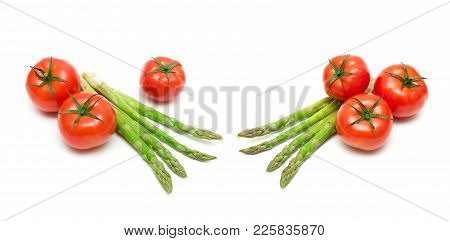Tomatoes And Asparagus On A White Background. Horizontal Photo.