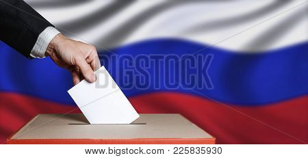 Voter Holds Envelope In Hand Above Vote Ballot On Russia Flag Background. Freedom Democracy Concept