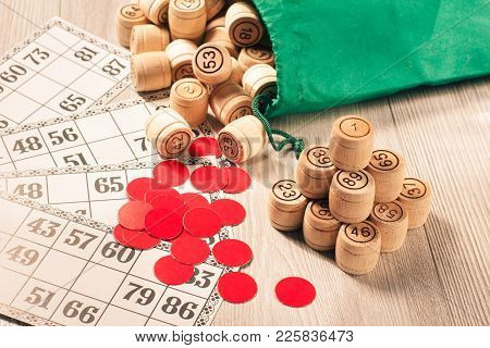 Board Game Lotto. Wooden Lotto Barrels With Green Bag, Red Chips And Game Cards For A Game In Lotto
