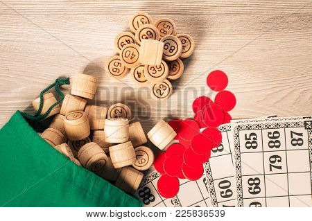Board Game Lotto. Wooden Lotto Barrels With Bag, Red Chips And Game Cards For A Game In Lotto. Top V