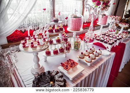Table With Sweets, Candy, Buffet. Dessert Table For A Party Goodies.