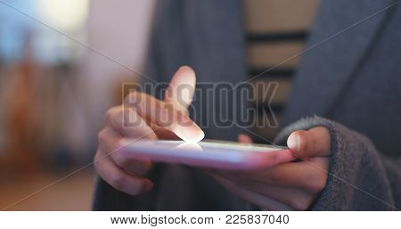 Woman shopping online on cellphone