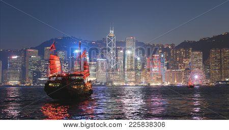 Victoria harbor, Hong Kong 17 January 2018:- - Sail junk boat travel in Victoria harbor in Hong Kong city at night