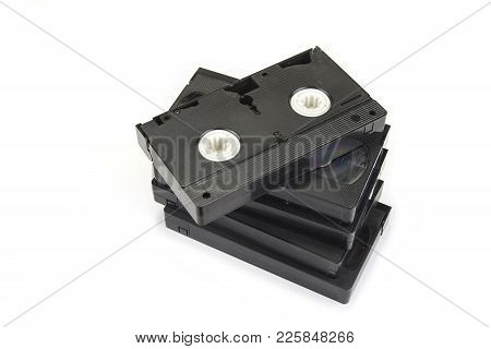 Pile Of Black Vhs Videotapes On The White Background