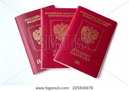 Three Passport Of The Citizen Of The Russian Federation On A White Background.